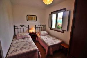 Een bed of bedden in een kamer bij Casa Finca Patelo