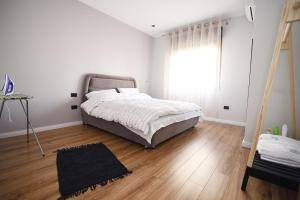 A bed or beds in a room at Skanderbeg Square Center Apartments