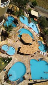 A view of the pool at Suíte no Thermas Place or nearby