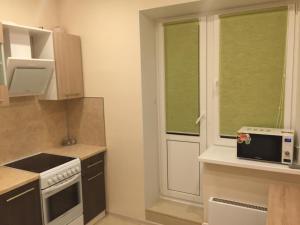 A kitchen or kitchenette at Апартаменты Пушкино