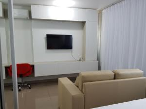 A television and/or entertainment center at Flat Smart Residence