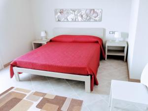 A bed or beds in a room at Residence San Rossore