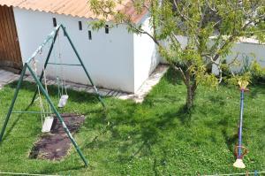 A garden outside Apartamentos Campos 0