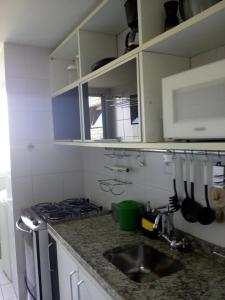 A kitchen or kitchenette at Ajuricaba Suites 6