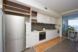 A kitchen or kitchenette at 1 Bright Point Apartment 5404