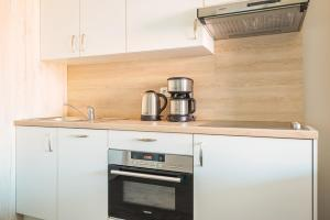 A kitchen or kitchenette at Holiday Suites Westende