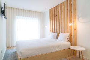 """Un ou plusieurs lits dans un hébergement de l'établissement Bracara Guest House """"D. Pedro V"""""""