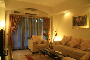 A seating area at Aditya Mansions Apartment