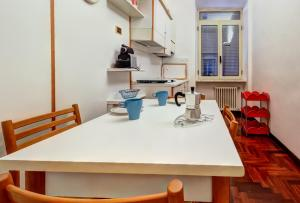 A kitchen or kitchenette at San Giovanni Comfort Apartment