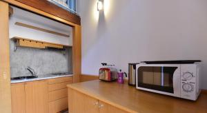 A kitchen or kitchenette at IzzHome Full Center Grand