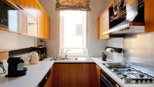 A kitchen or kitchenette at Fontana Di Trevi Penthouse