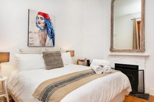 De Waterkant Cottage tesisinde bir odada yatak veya yataklar