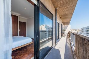 A balcony or terrace at TPC Tullins Palmeira