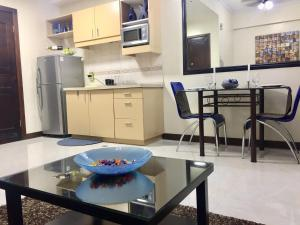 A kitchen or kitchenette at MCH Suites at Le Mirage De Malate