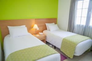 A bed or beds in a room at Jardines del Sol By Diamond Resorts