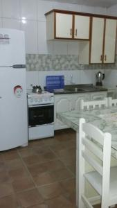 A kitchen or kitchenette at Casa Sonia