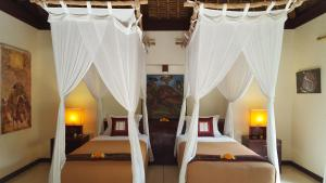 A bed or beds in a room at Villa Purnamasari