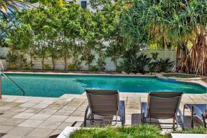 The swimming pool at or near Indigo Blue
