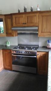 A kitchen or kitchenette at Secret Garden Villa 4