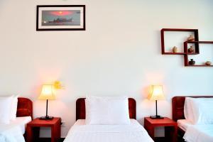 Un ou plusieurs lits dans un hébergement de l'établissement Villa Nanda
