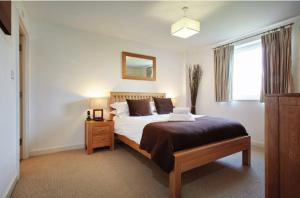 A bed or beds in a room at Riverbank Point By Flying Butler