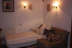 מיטה או מיטות בחדר ב-Prestlhof