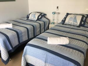 A bed or beds in a room at Carrington Court
