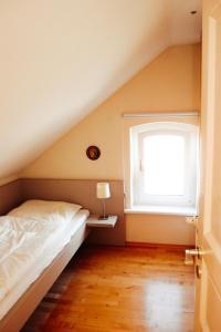 Ein Bett oder Betten in einem Zimmer der Unterkunft Ferienhaus Nummer Een