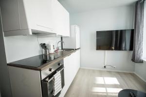 A kitchen or kitchenette at Stavanger Housing Hotel