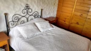 Una cama o camas en una habitación de Lo de Adonis