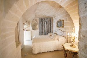 Letto o letti in una camera di Angolo Fiorito