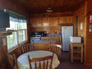 A kitchen or kitchenette at Sea'scape Cottages