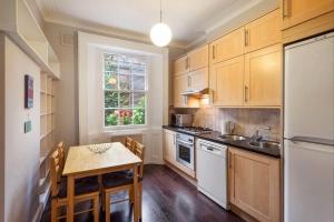 A kitchen or kitchenette at Private Maisonette