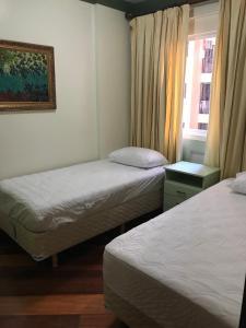 A bed or beds in a room at Apartamento Luxo Balneário Camboriú