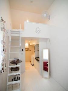 A bunk bed or bunk beds in a room at Fttakuya Apartment in Shinjuku 206