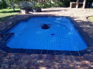 The swimming pool at or near Island Cottage