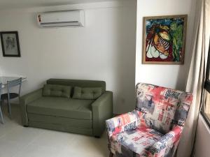 Zona de estar de Flat a 150 Metros da Praia