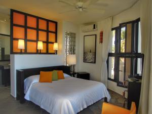A bed or beds in a room at El Magnifico