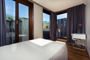 Lova arba lovos apgyvendinimo įstaigoje Konrad Old Town ApartHotel