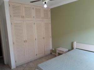 A bed or beds in a room at Edifício Torre de Prata