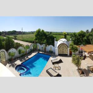 A view of the pool at Les Appartements de la Concorde or nearby