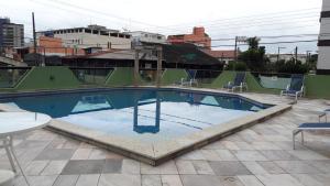 The swimming pool at or near Apartamento Vereda Tropical