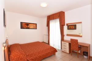 Letto o letti in una camera di Hotel Villa Olga