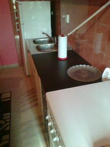 A kitchen or kitchenette at Apartment Kastel Stafilic 11022b
