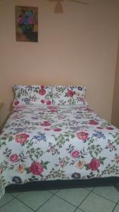 A bed or beds in a room at Home Sweet Home