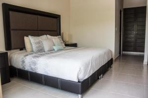 A bed or beds in a room at Natura Tulum
