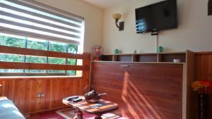 Una televisión o centro de entretenimiento en Peumayén Departamento Pucón