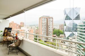 Uma varanda ou terraço em Departamento Amoblado Las Condes