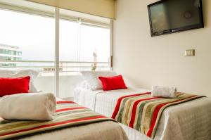 Cama ou camas em um quarto em Departamento Amoblado Las Condes