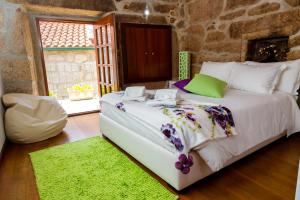 A bed or beds in a room at Casa Rautau